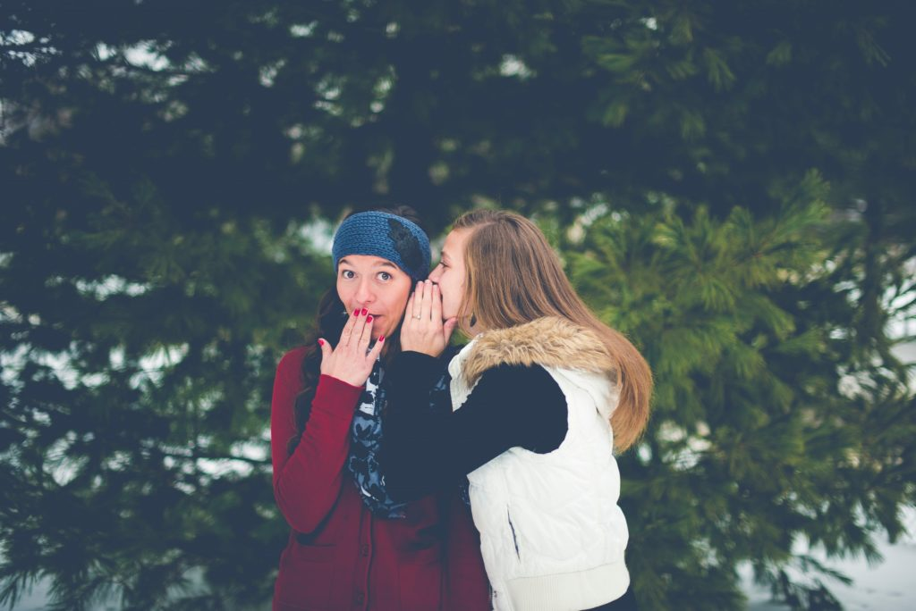 friends talking in snow