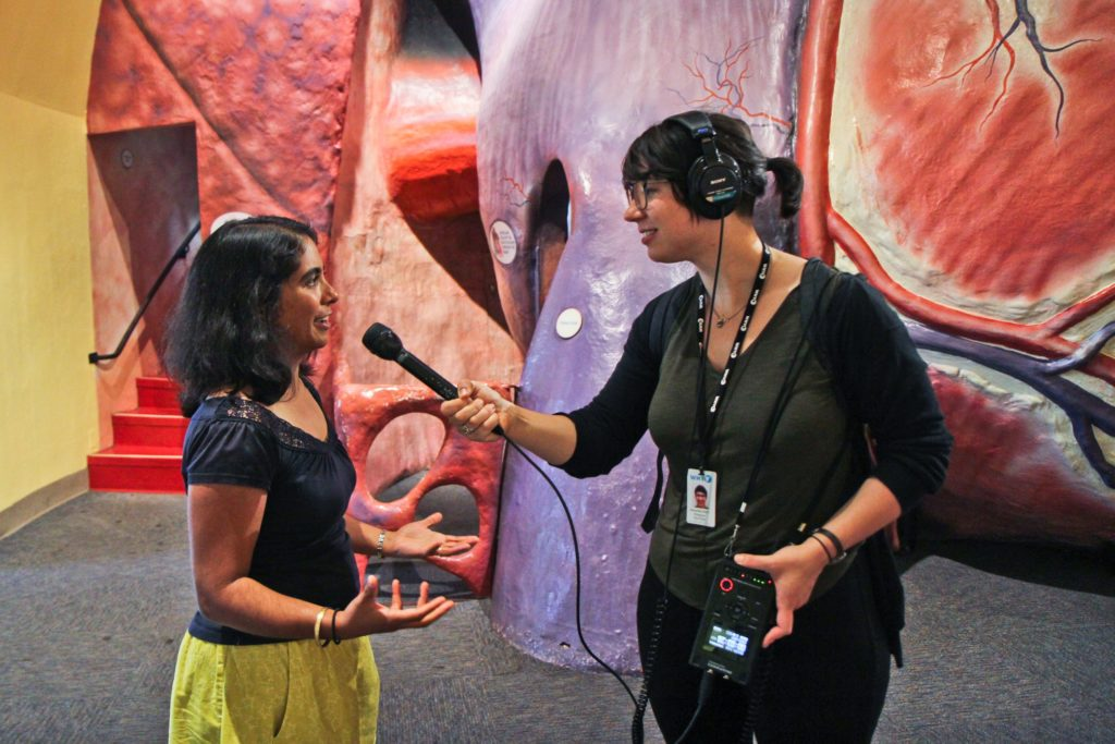franklin institute internships lady interviewing and recording