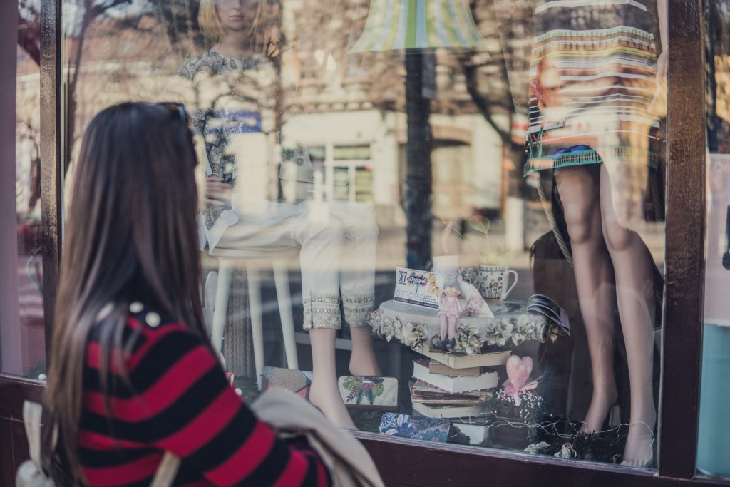 Woman Looking Through Shop Window
