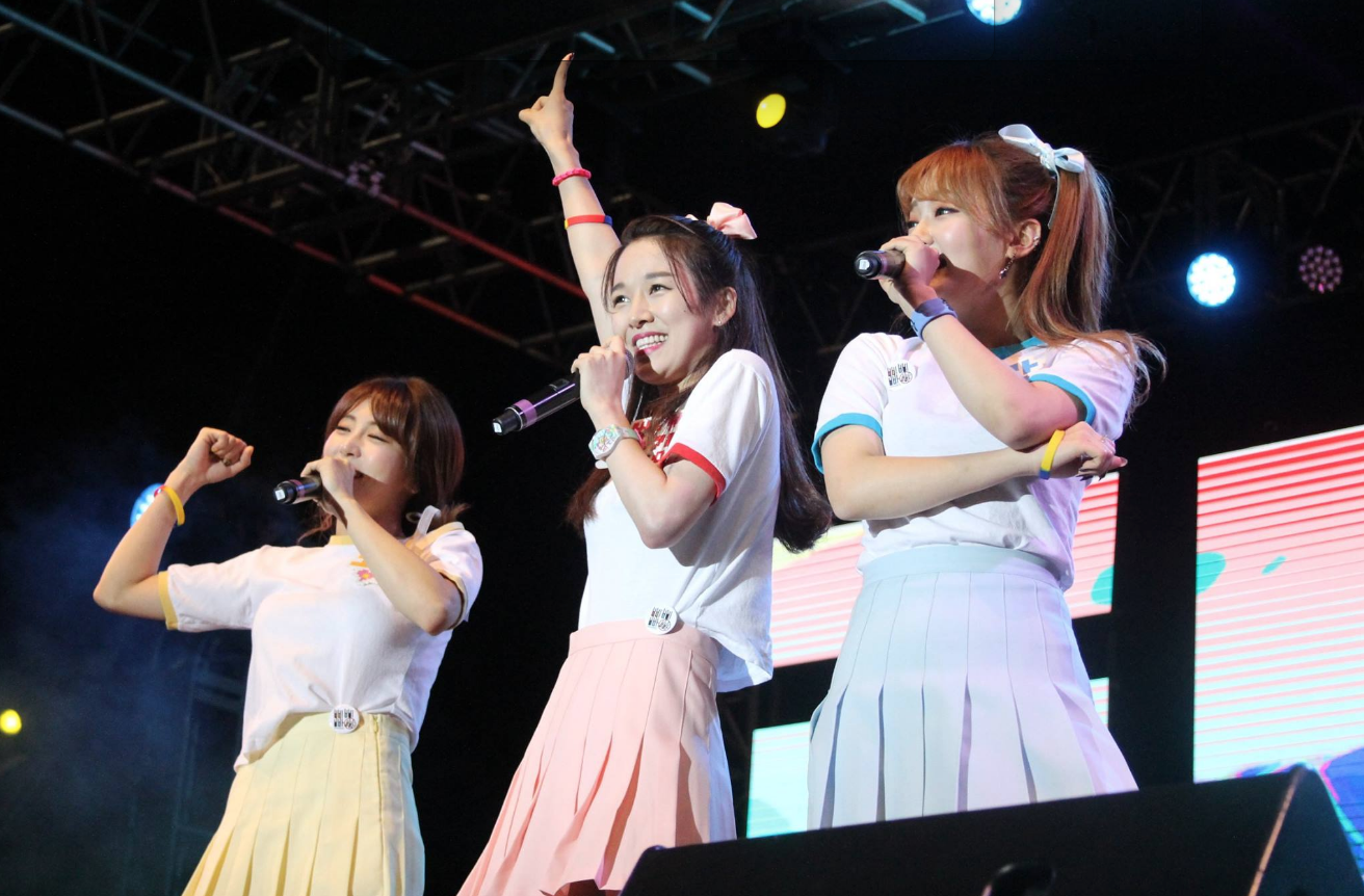Group of korean pop siingers performing on the main stage at the festival.