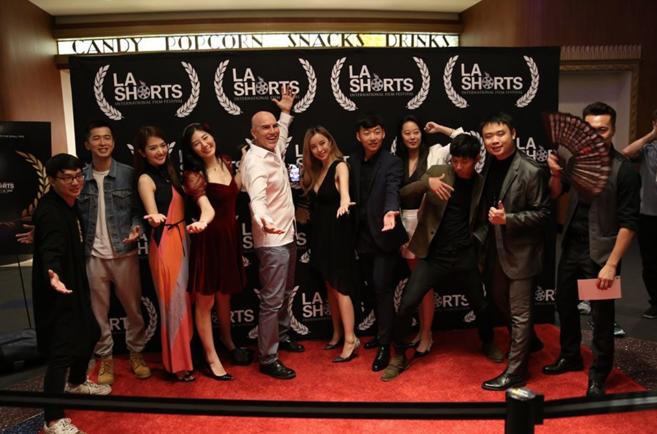 A group of people attend the L.A Shorts Fest and gather together for a picture