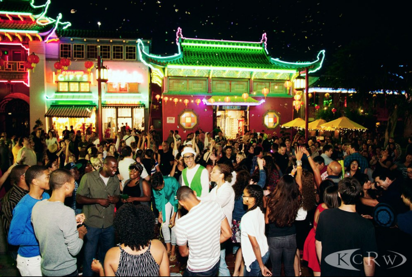 A group of people celebrate at Chinatown Summer Nights