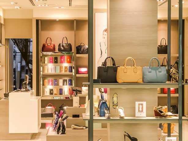 Luxury handbags displayed in store.