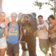 UCLA admitted freshmen standing next to the bruin bear as they pose for a picture