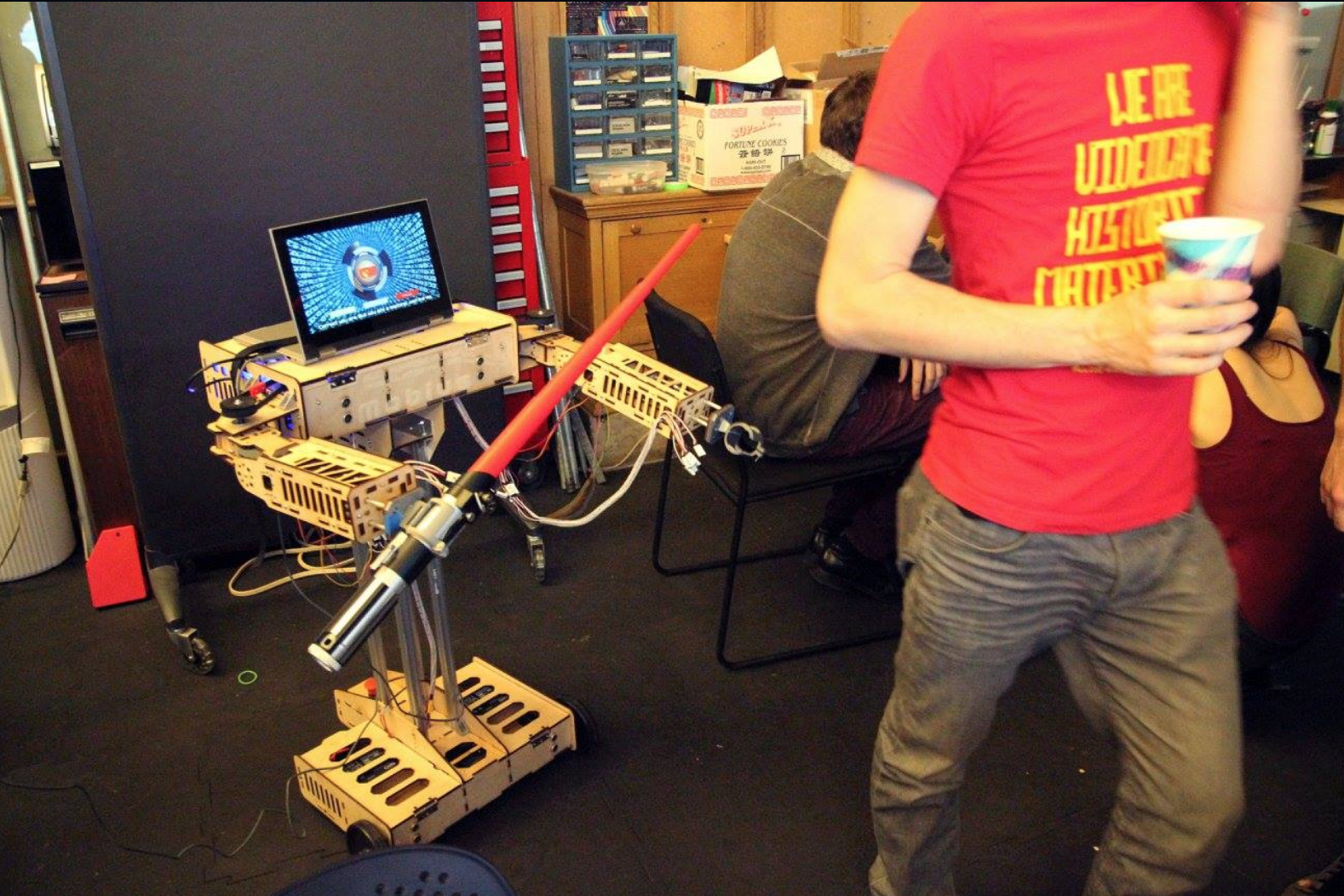 a display of an experimental game design project made of a computer and lightsaber