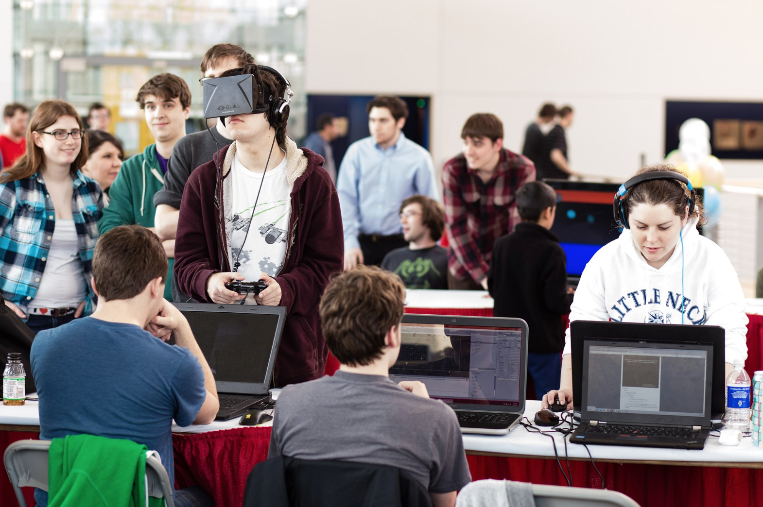 student using a VR system with other students on campus