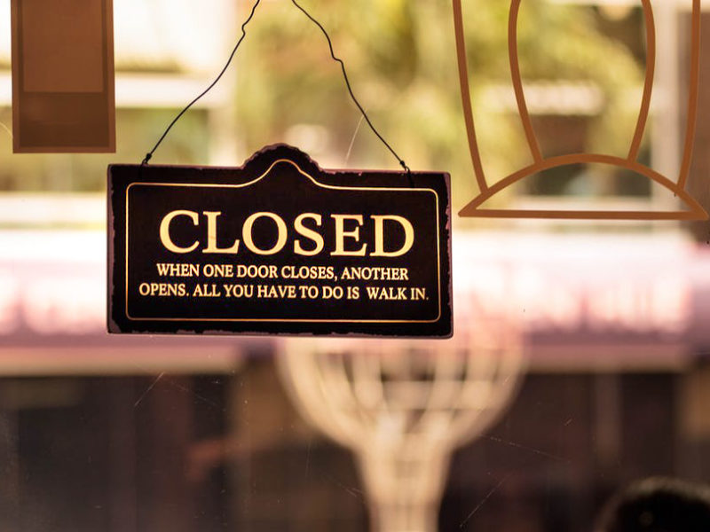 Closed sign hangs in a campus coffee shop's window.