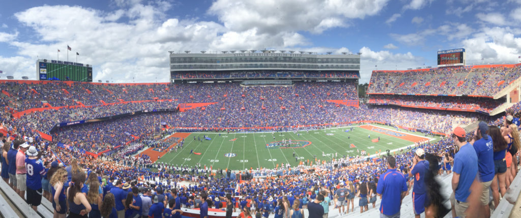 "A panoramic view of ""The Swamp"" during a football game."