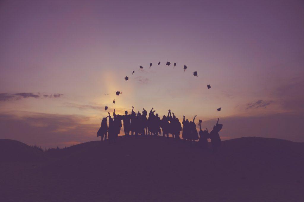 graduates-throwing-caps