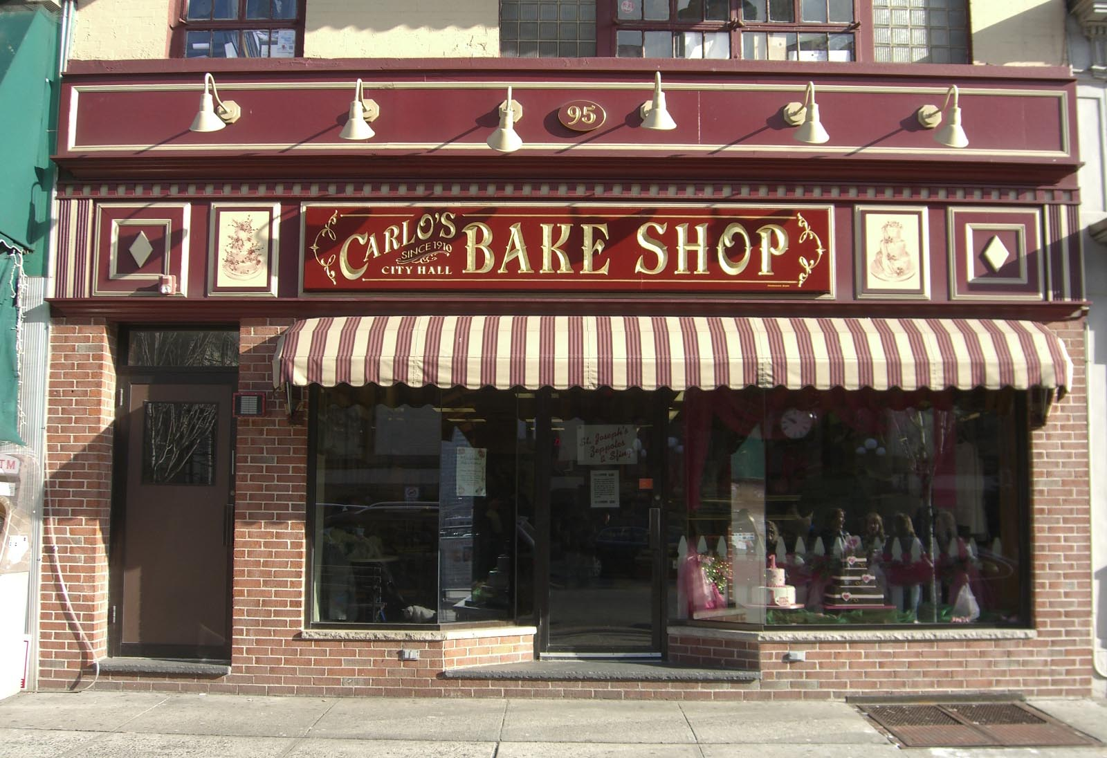 Carlos bake shop awning red and white