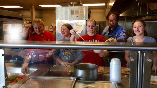 Volunteers serve lunch at Central Iowa Shelters and Services.