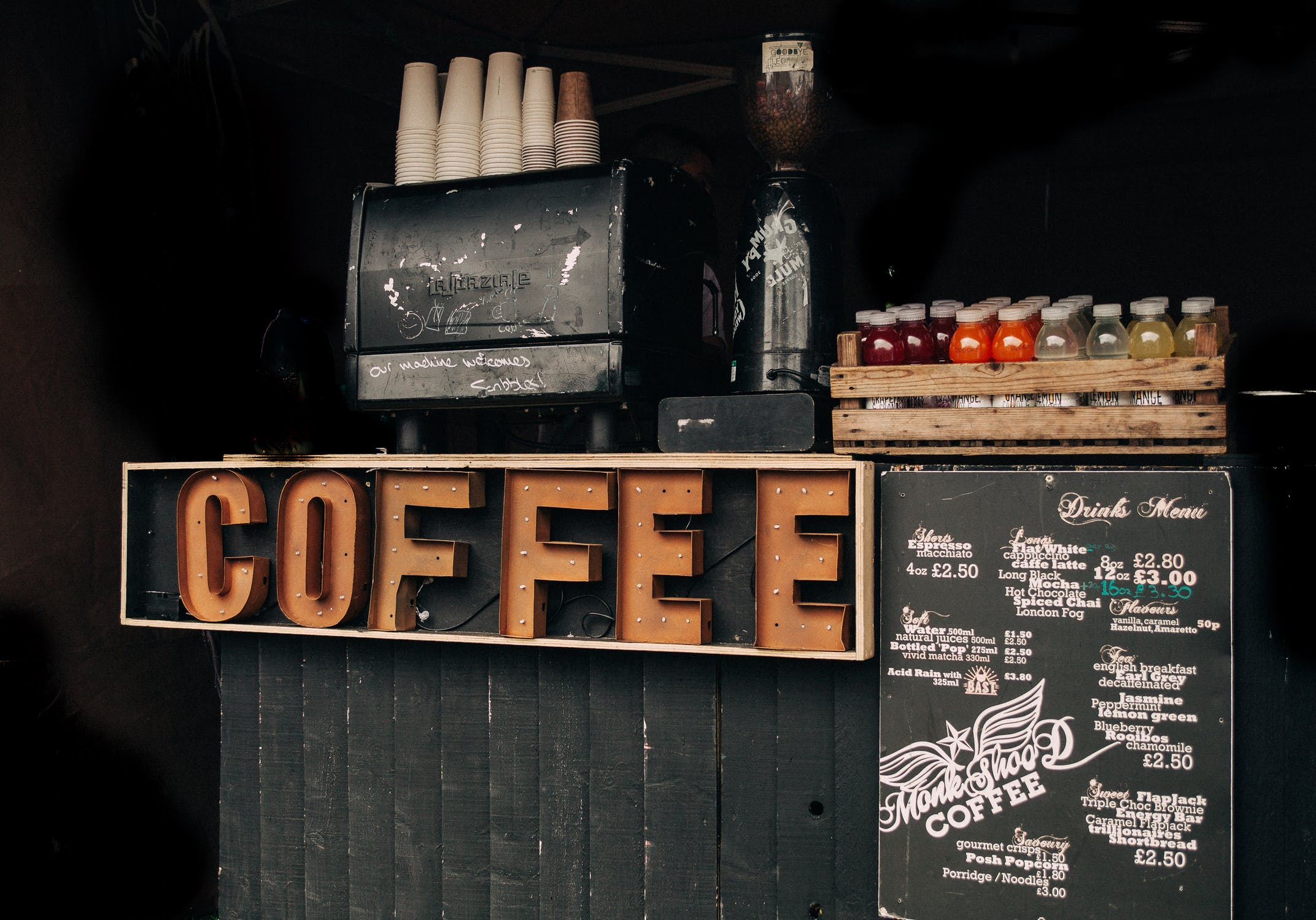 signs saying coffee with a list of flavors