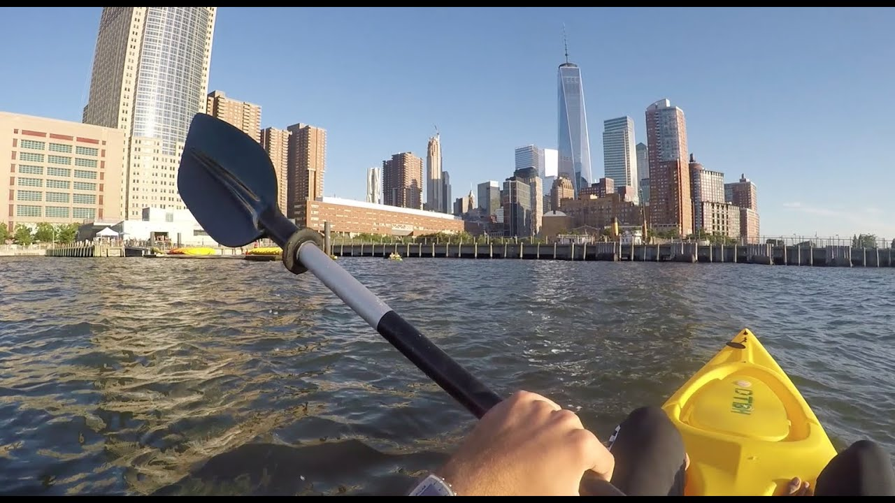 hand paddling on Hudson River overlooking nyc