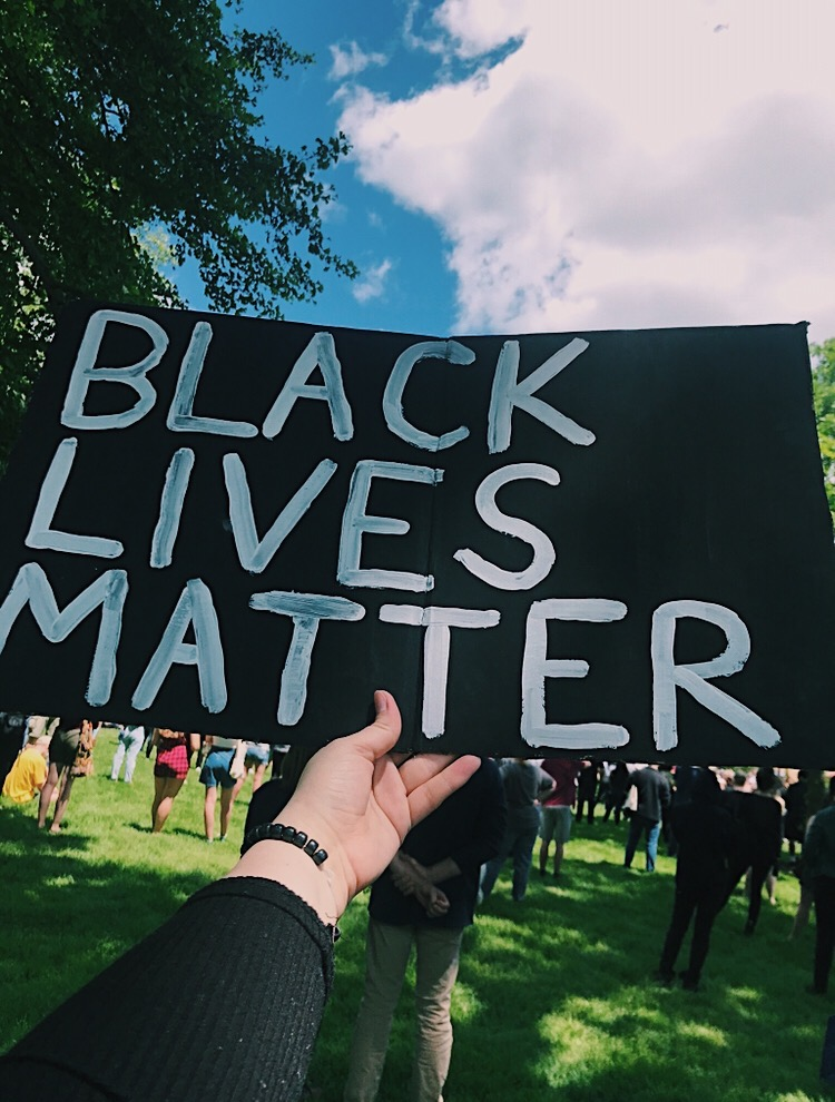 A person holds up a Black Lives Matters sign