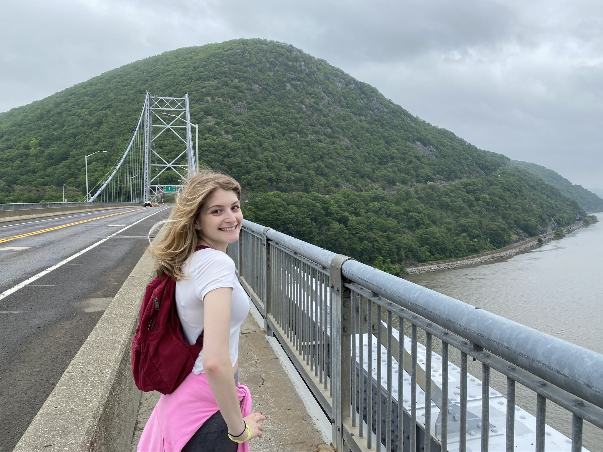 me on the bridge in front of mountains