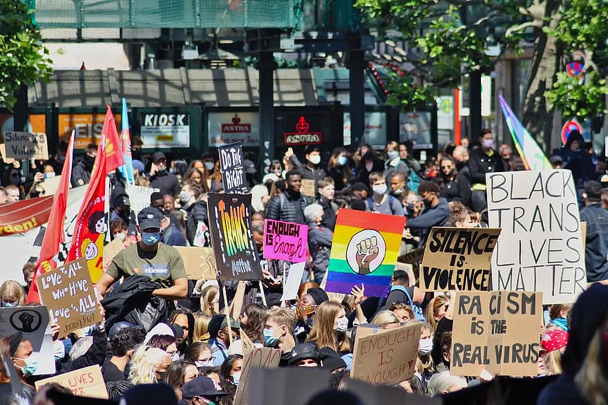 A crowd of people support Pride and Black Lives Matter.