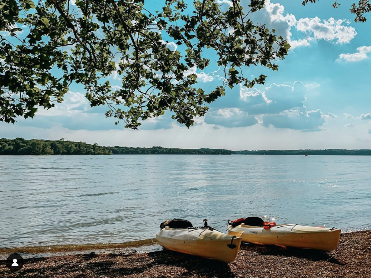 two kayaks sitting on the shore of Percy Priest Lake