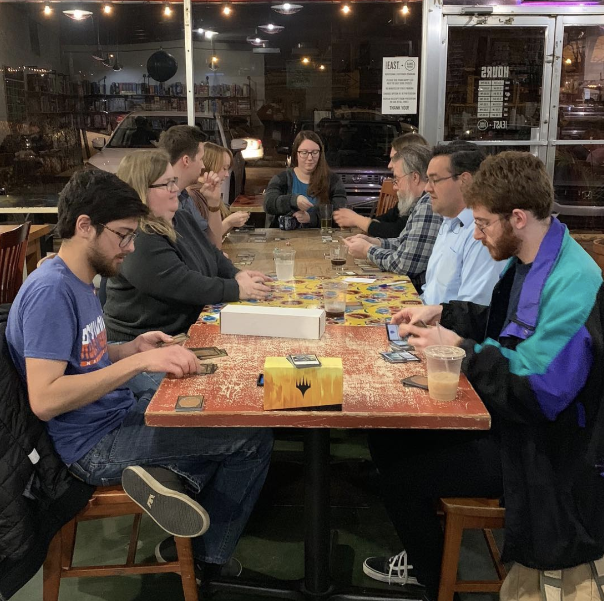 people playing board games at the Game Point Cafe