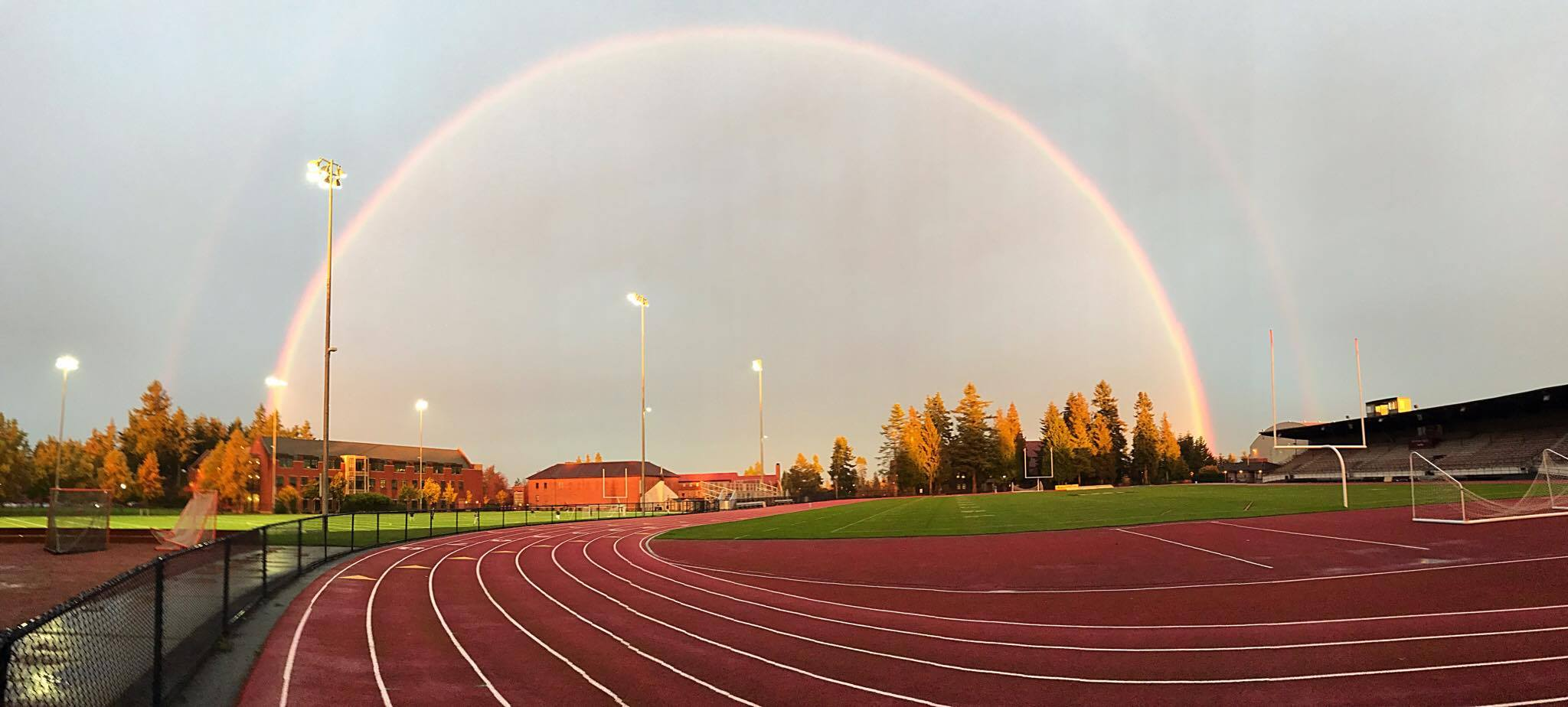 puget sound track field with a rainbow
