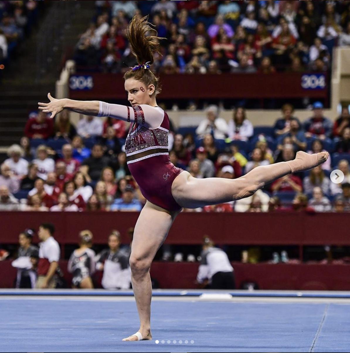 a gymnast dancing on the floor