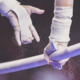 hands on the uneven bars