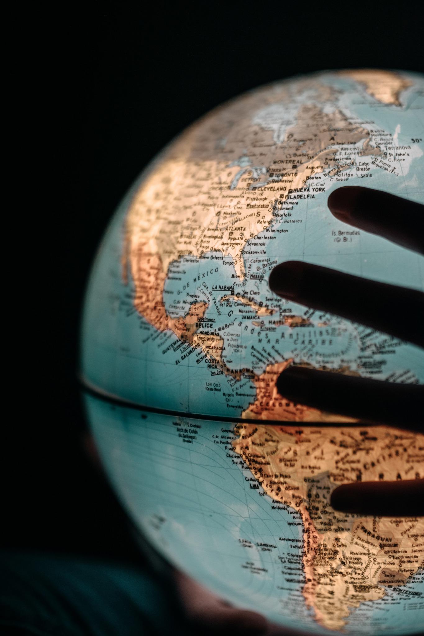 Hands holding world globe