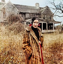 Edie Beale in front of her house