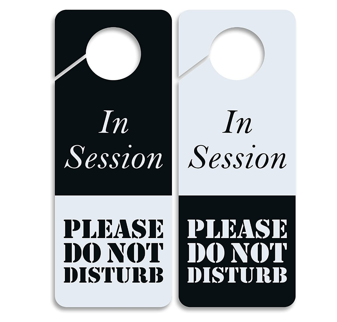 two versions of black and white do not disturb door hangers