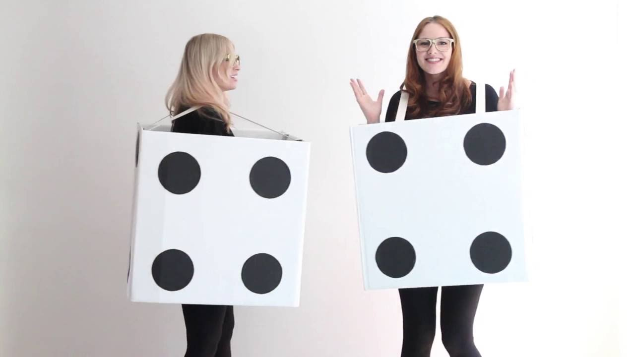 two girls in white boxes with black circles like dice
