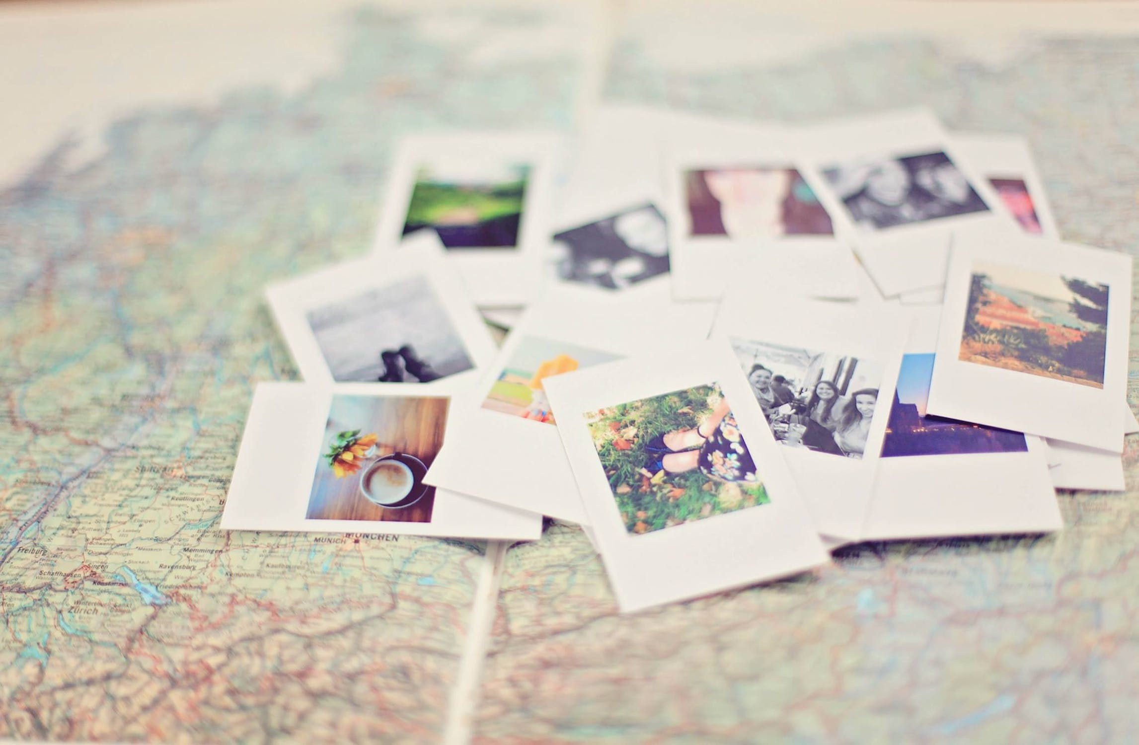 world map with polaroids