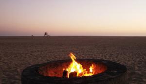 A bonfire burns on the Huntington Beach sand.