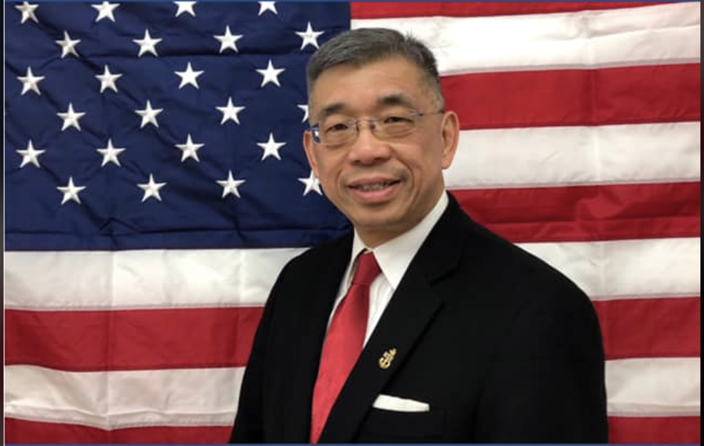 photo of Lester chang and the American flag