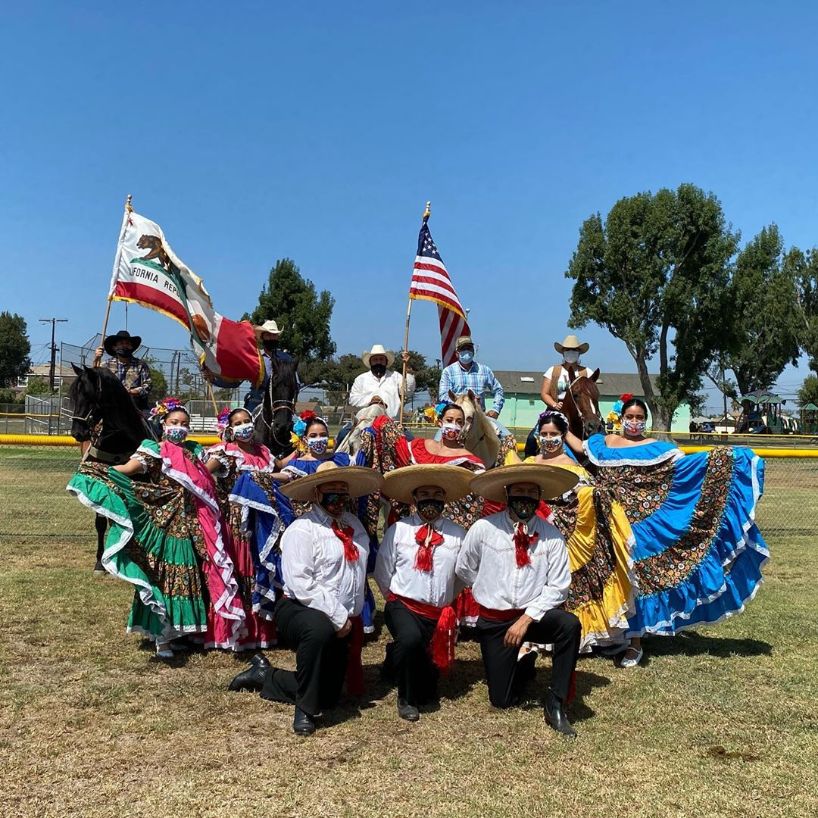 Grupo Folklorico Latinx dancers posing for a picture.