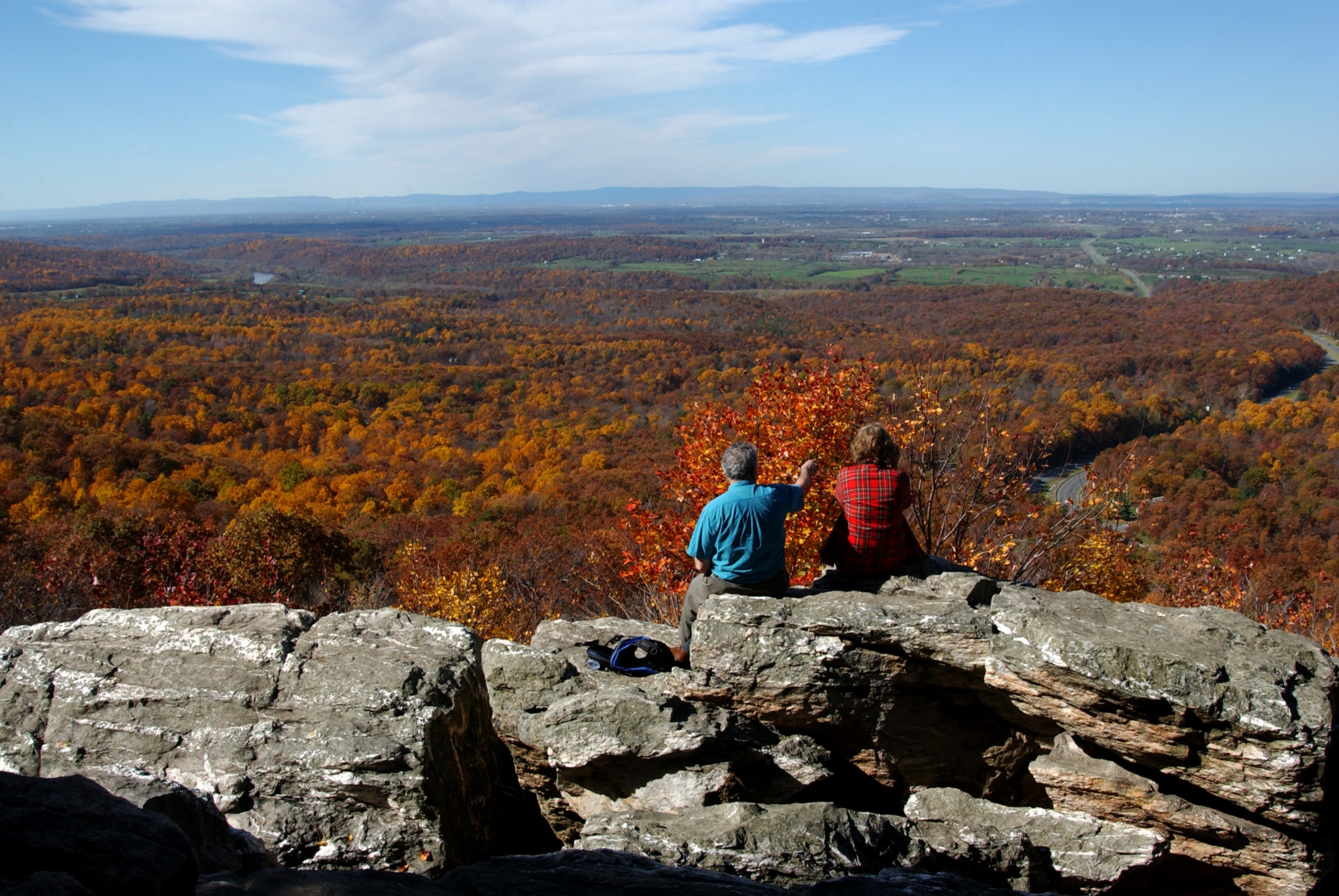 Two people overlooking the Shenandoah Valley in fall