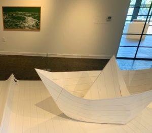 A large paper boat inside an OC art exhibit.