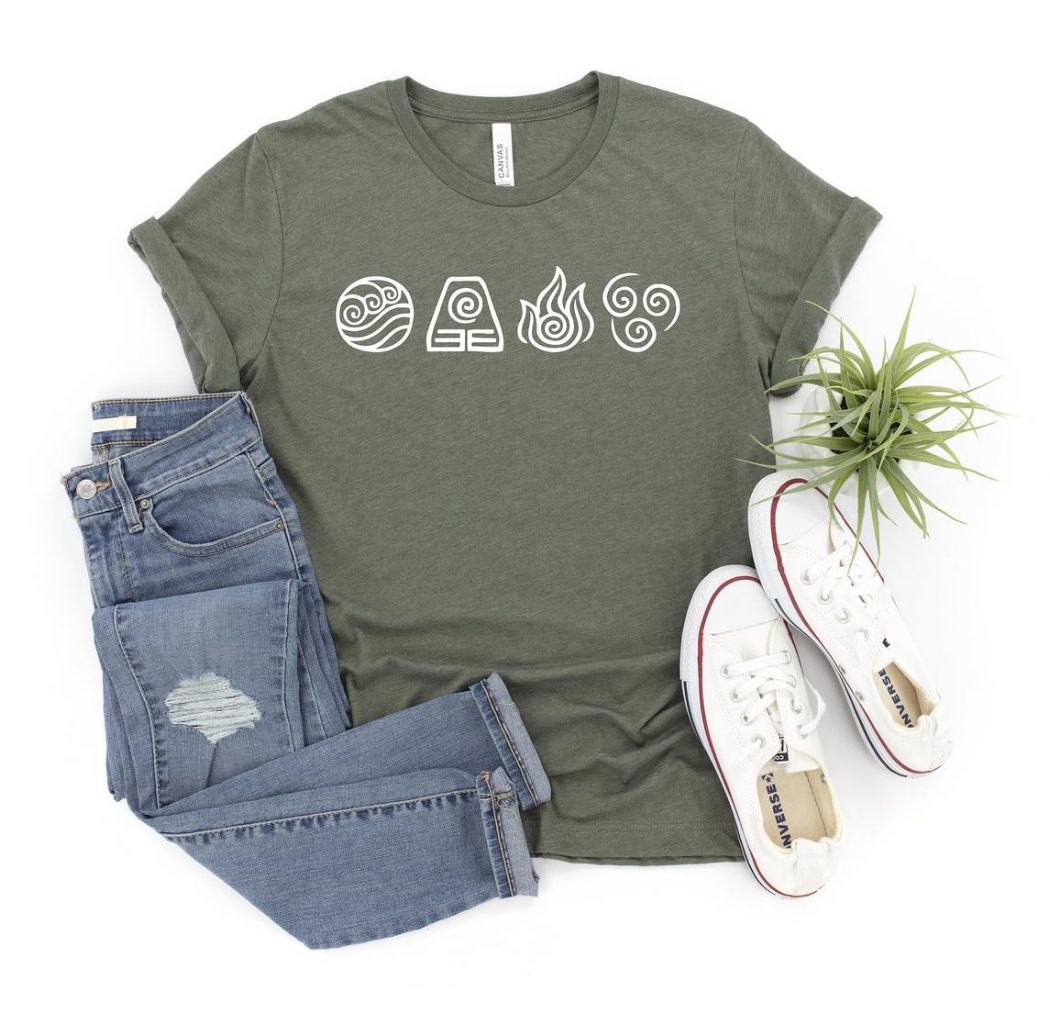 avatar t shirt displayed with pants, shoes and plants