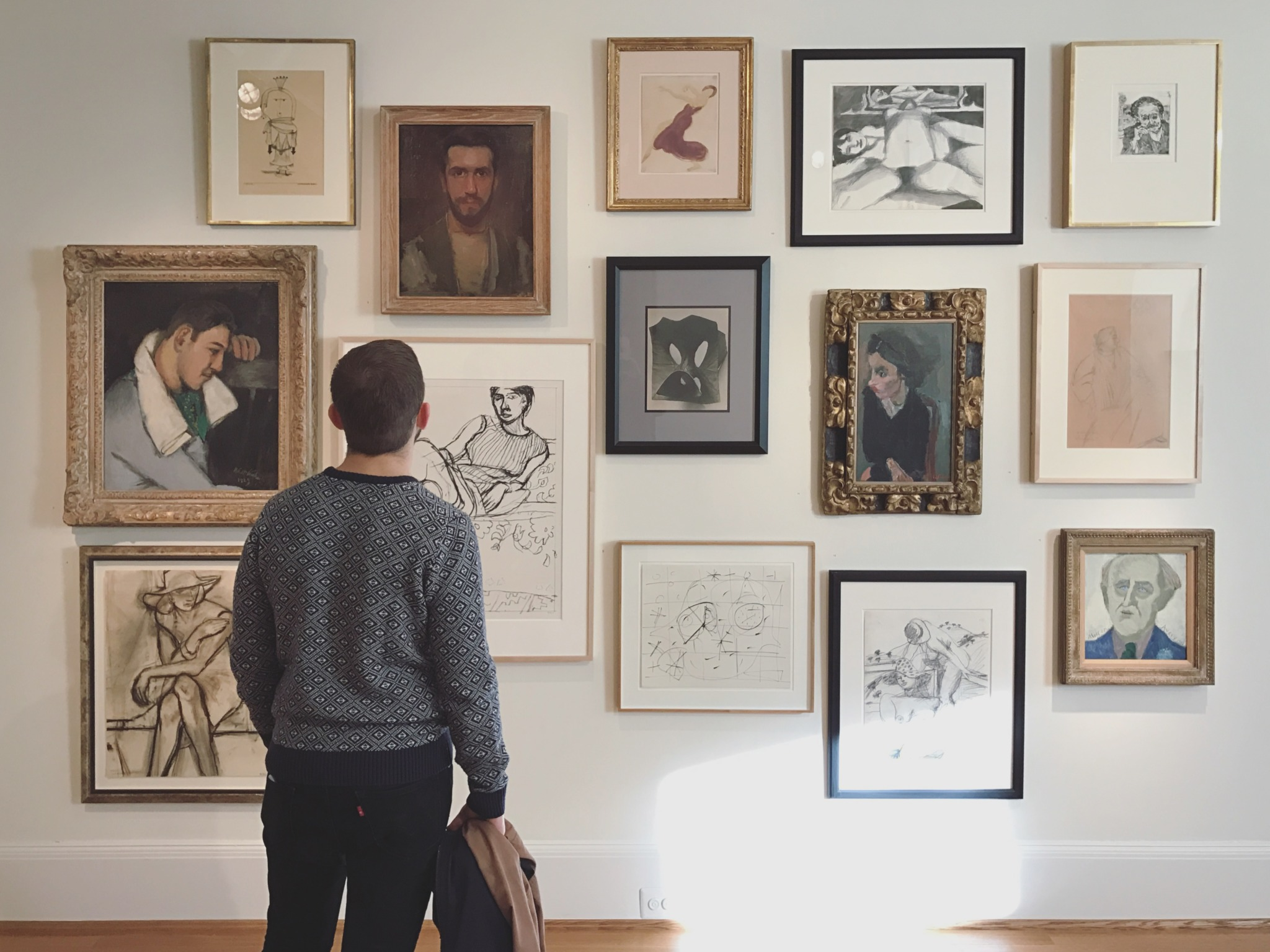 Man Looks at Phillips Collection Paintings