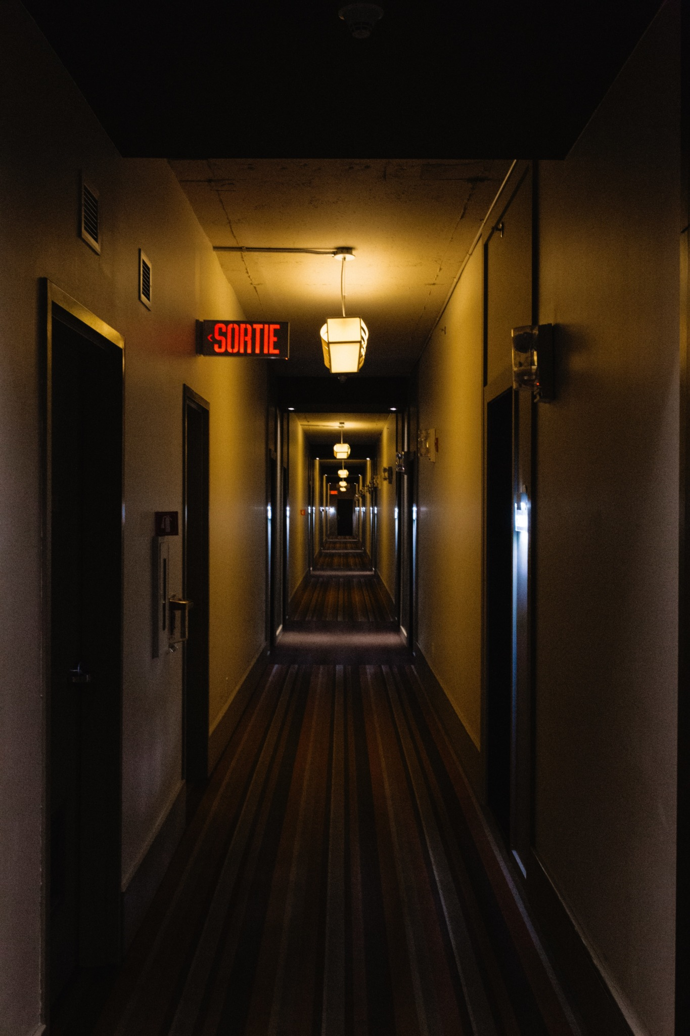 A gray and brown wooden hallway.